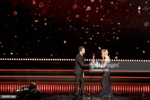 Actress Valeria Bruni Tedeschi receives the Best Actress Award from Claudio Santamaria during the 61 David Di Donatello ceremony on March 27 2017 in...