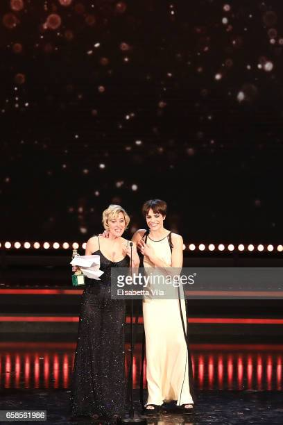 Actress Valeria Bruni Tedeschi receives the Best Actress Award with Micaela Ramazzotti during the 61 David Di Donatello ceremony on March 27 2017 in...