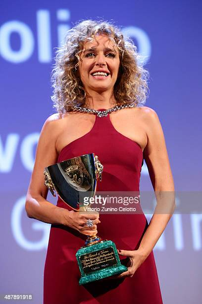 Actress Valeria Golino on stage with the Coppa Volpi for Best Actress award for the movie 'Per Amore Vostro' at the closing ceremony during the 72nd...