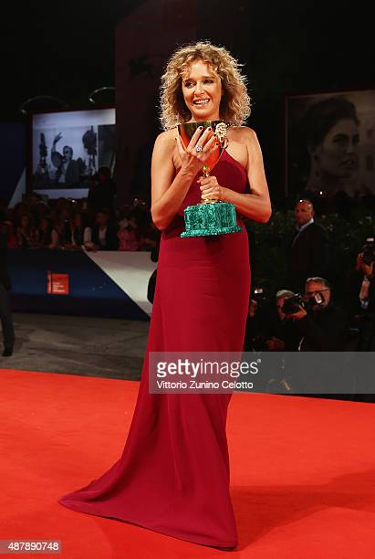 Actress Valeria Golino poses with the Coppa Volpi for Best Actress Award for the movie 'Per Amore Vostro' as she attends the award winners photocall...