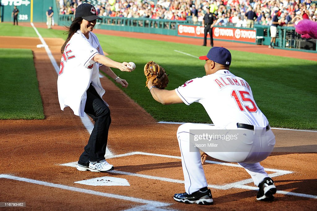 Actress Valerie Bertinelli runs her first pitch to Sandy Alomar, Jr. #15 of the Cleveland Indians prior to the game game between the Cleveland Indians and the Pittsburgh Pirates at Progressive Field on June 17, 2011 in Cleveland, Ohio.