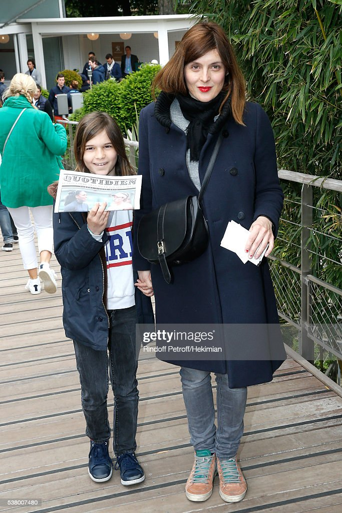 Actress Valerie Donzelli and her daughter Rebecca attend Day Fourteen Women single's Final of the 2016 French Tennis Open at Roland Garros on June 4...