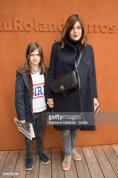 Actress Valerie Donzelli and her son attend day Fourteen of the 2016 French Open at Roland Garros on June 4 2016 in Paris France