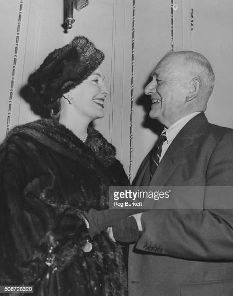Actress Valerie Hobson and publicist W J MacQueenPope chatting at a Foyles Literary Luncheon for the publication of his new book 'Nights of Gladness'...