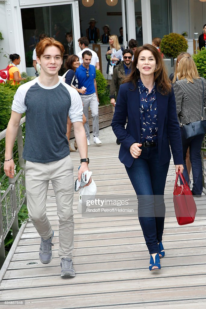 Actress <a gi-track='captionPersonalityLinkClicked' href=/galleries/search?phrase=Valerie+Kaprisky&family=editorial&specificpeople=1623207 ng-click='$event.stopPropagation()'>Valerie Kaprisky</a> and her Nephew attend Day Seven of the 2016 French Tennis Open at Roland Garros on May 28, 2016 in Paris, France.