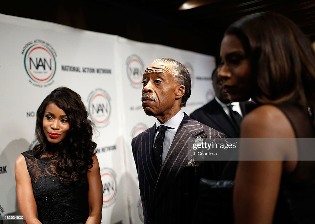 Actress Valisia Lekae (L) and President and founder of the National Action Network Reverend Al Sharpton (C) backstage at The 4th Annual Triumph Awards at Rose Theater, Jazz at Lincoln Center on October 7, 2013 in New York City.