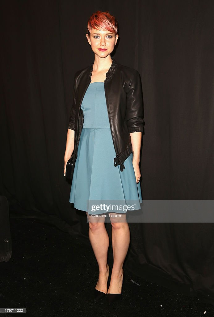 Actress Valorie Curry poses backstage at the Rebecca Minkoff Spring 2014 fashion show during Mercedes-Benz Fashion Week at The Theatre at Lincoln Center on September 6, 2013 in New York City.