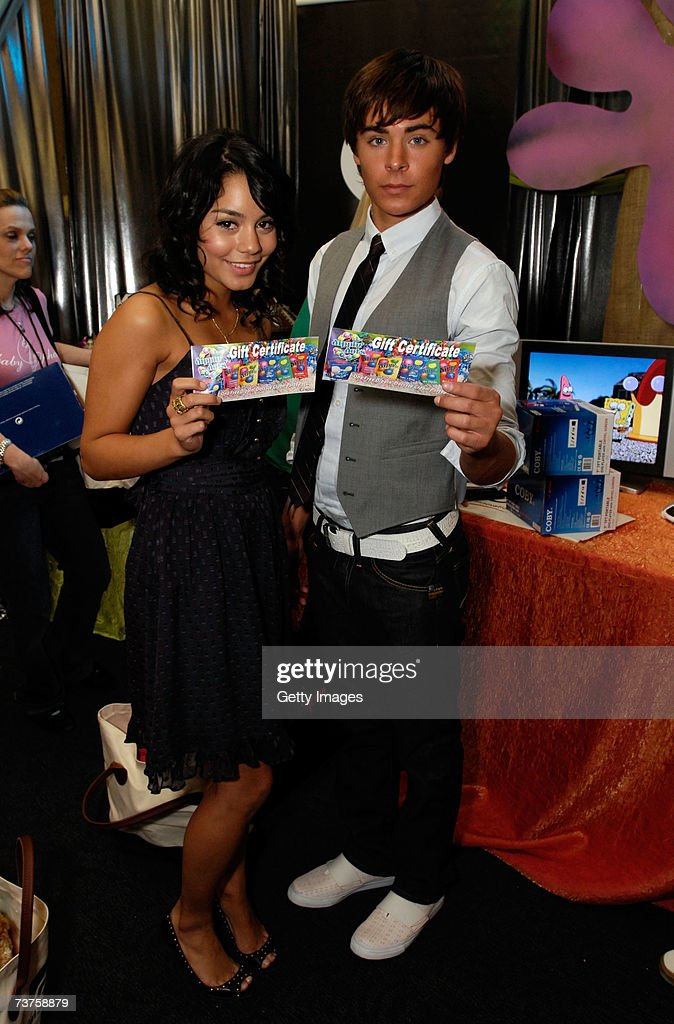 Actress Vanessa Anne Hudgens and actor Zac Efron pose with the Dippin' Dots gift certificate in the Distinctive Assets gift lounge during the 20th...