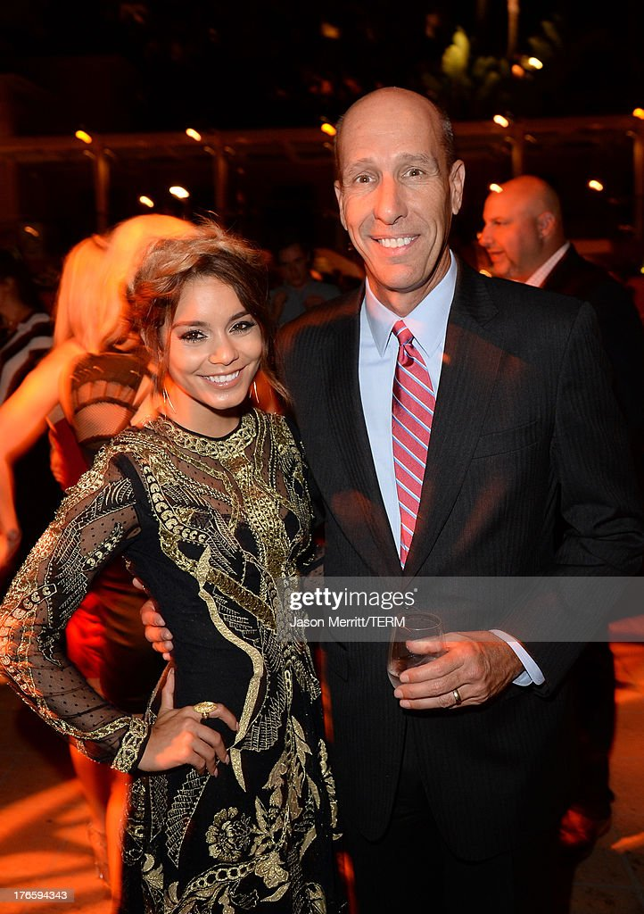 Actress Vanessa Hudgens (L) and president and chief executive officer of the Make-A-Wish Foundation David A. Williams attends WWE & E! Entertainment's 'SuperStars For Hope' at the Beverly Hills Hotel on August 15, 2013 in Beverly Hills, California.