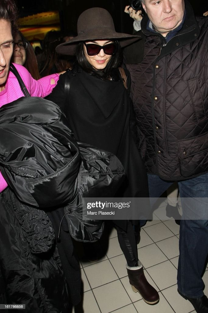 Actress Vanessa Hudgens (C) arrives at Roissy airport on February 16, 2013 in Paris, France.