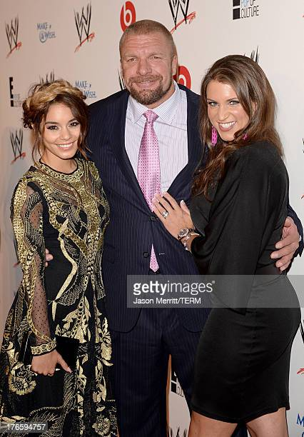 Actress Vanessa Hudgens professional wreslter Paul Levesque and WWE Executive Vice President of Creative Stephanie McMahon attend WWE E...