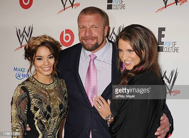 Actress Vanessa Hudgens professional wreslter Paul 'Triple H' Levesque and WWE Executive Vice President of Creative Stephanie McMahon attend WWE E...