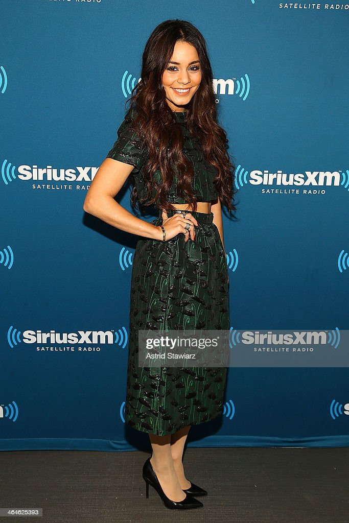 Actress Vanessa Hudgens, wearing a cropped top and skirt by Topshop, visits the SiriusXM Studios on January 23, 2014 in New York City.