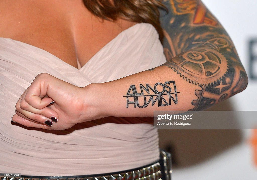 Actress Vanessa Leigh (tattoo detail) arrives at the 'Almost Human' Premiere during the 2013 Toronto International Film Festival at Ryerson Theatre on September 10, 2013 in Toronto, Canada.