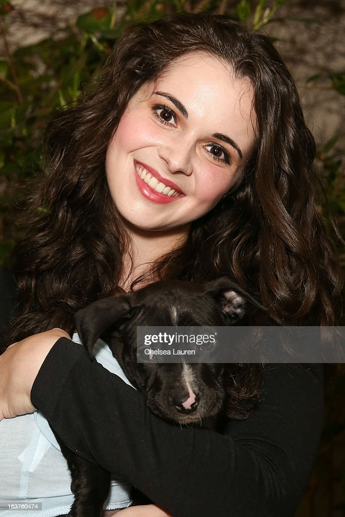 Actress Vanessa Marano poses with a dog wearing Lyric Culture for PetSmart at Much Love Animal Rescue's makeovers for mutts at Peninsula Hotel on March 14, 2013 in Beverly Hills, California.