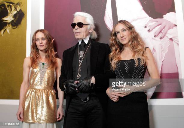 actress Vanessa Paradis designer Karl Lagerfeld and actress Sarah Jessica Parker pose for photographs during The Little Black Jacket Exhibition...