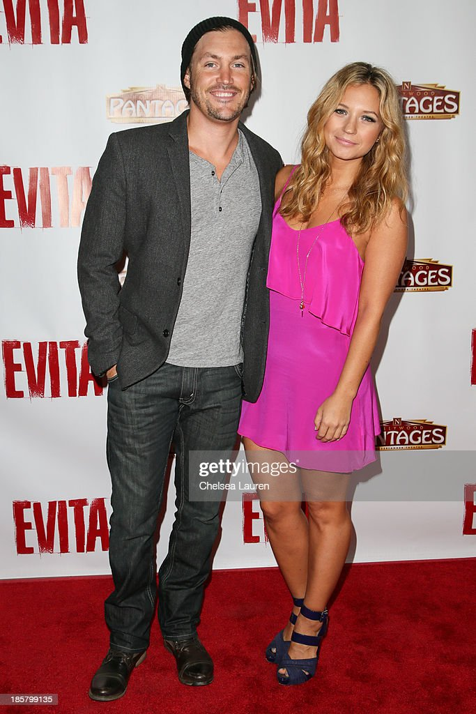 Actress Vanessa Ray (R) arrives at the opening night red carpet for 'Evita' at the Pantages Theatre on October 24, 2013 in Hollywood, California.