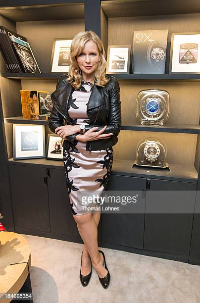 Actress Veronica Ferres poses withe the long case clock 'Atmos 566' during the JaegerLeCoultre Boutique Opening on October 14 2013 in Frankfurt am...