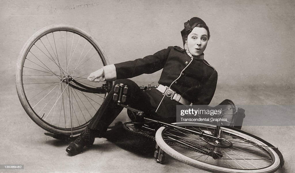 Actress Vesta Tilley and her bicycle pose for a publicity postcard circa 1910 in London, England.