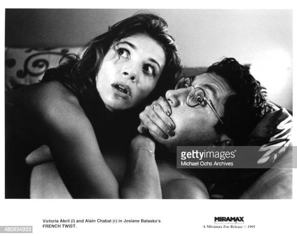 Actress Victoria Abril and actor Alain Chabat in a scene from the Miramax movie ' French Twist ' circa 1995