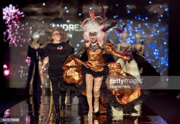 Actress Victoria Abril and designer Nuria Sarda walk the runway at the Andres Sarda show during the MercedesBenz Madrid Fashion Week Autumn/Winter...