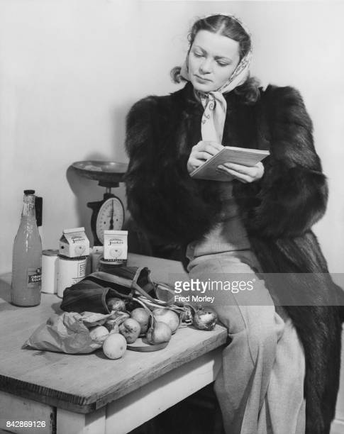 Actress Victoria Hopper checks her groceries after a shop UK 23rd November 1946 She is starring in 'Vanity Fair' at the Comedy Theatre in London