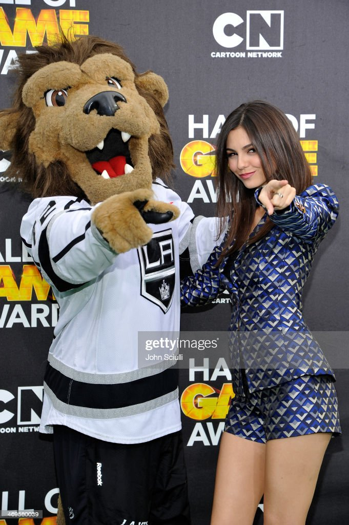 Actress Victoria Justice and Los Angeles Kings mascot Bailey attend Cartoon Network's fourth annual Hall of Game Awards at Barker Hangar on February...