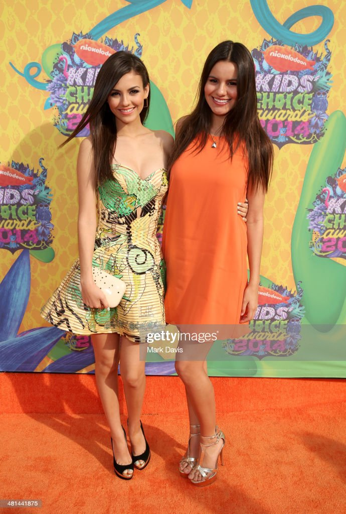 Actress <a gi-track='captionPersonalityLinkClicked' href=/galleries/search?phrase=Victoria+Justice&family=editorial&specificpeople=569887 ng-click='$event.stopPropagation()'>Victoria Justice</a> and sister Madison Reed attend Nickelodeon's 27th Annual Kids' Choice Awards held at USC Galen Center on March 29, 2014 in Los Angeles, California.