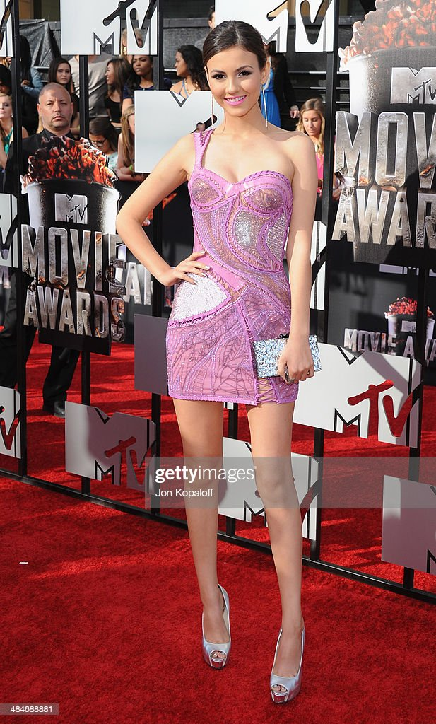 Actress <a gi-track='captionPersonalityLinkClicked' href=/galleries/search?phrase=Victoria+Justice&family=editorial&specificpeople=569887 ng-click='$event.stopPropagation()'>Victoria Justice</a> arrives at the 2014 MTV Movie Awards at Nokia Theatre L.A. Live on April 13, 2014 in Los Angeles, California.