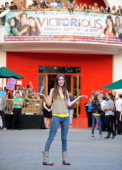 Actress Victoria Justice performs during the 'All I Want Is Everything' flash mob before greeting fans and signing copies of the 'Victorious'...