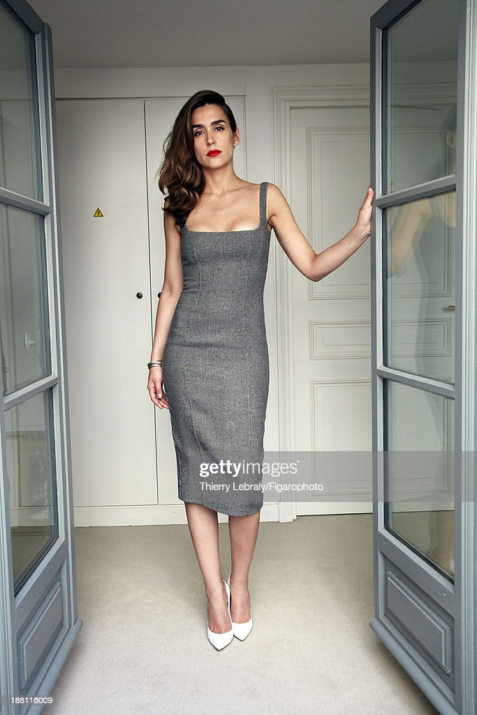 107384-002. Actress Victoria Olloqui is photographed for Madame Figaro on July 7, 2013 in Paris, France. Dress (DSquared2), shoes (Gianvito Rossi). PUBLISHED IMAGE.