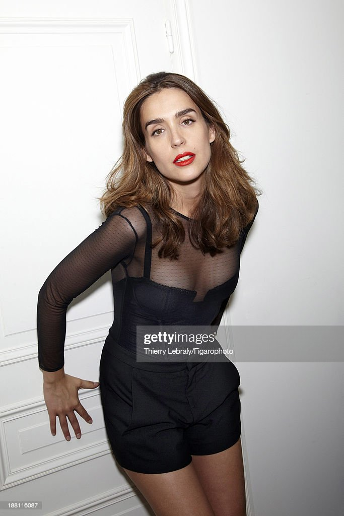 107384-008. Actress Victoria Olloqui is photographed for Madame Figaro on July 7, 2013 in Paris, France. Top (Cadolle), shorts (Maje).