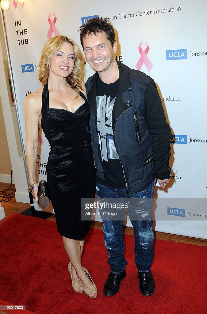 Actress Victoria Pratt and photographer TJ Scott attend TJ Scott's 'In The Tub' Book Party Launch to benefit UCLA's Jonsson Cancer Center for Breast Research hosted by Katrina Law of 'Spartacus' held at Light In Art on December 12, 2013 in Los Angeles, California.