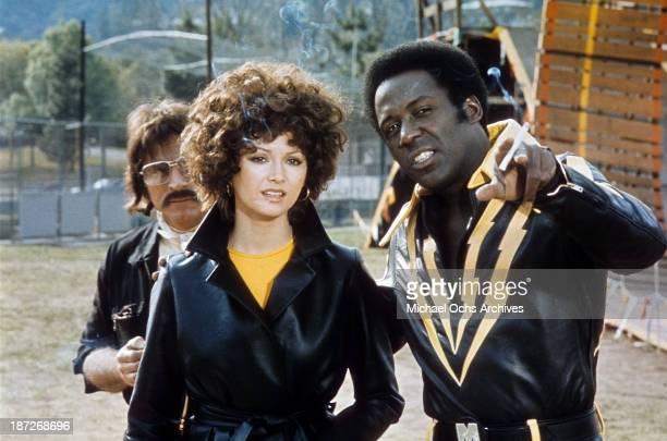 Actress Victoria Principal and actor Richard Roundtree on set for the movie 'Earthquake' Circa 1974