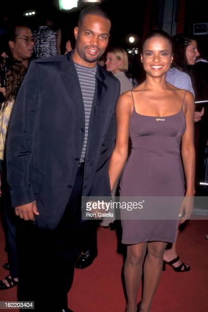 Actress Victoria Rowell and guest attend the 'Boogie Nights' Hollywood Premiere on October 15 1997 at Mann's Chinese Theatre in Hollywood California