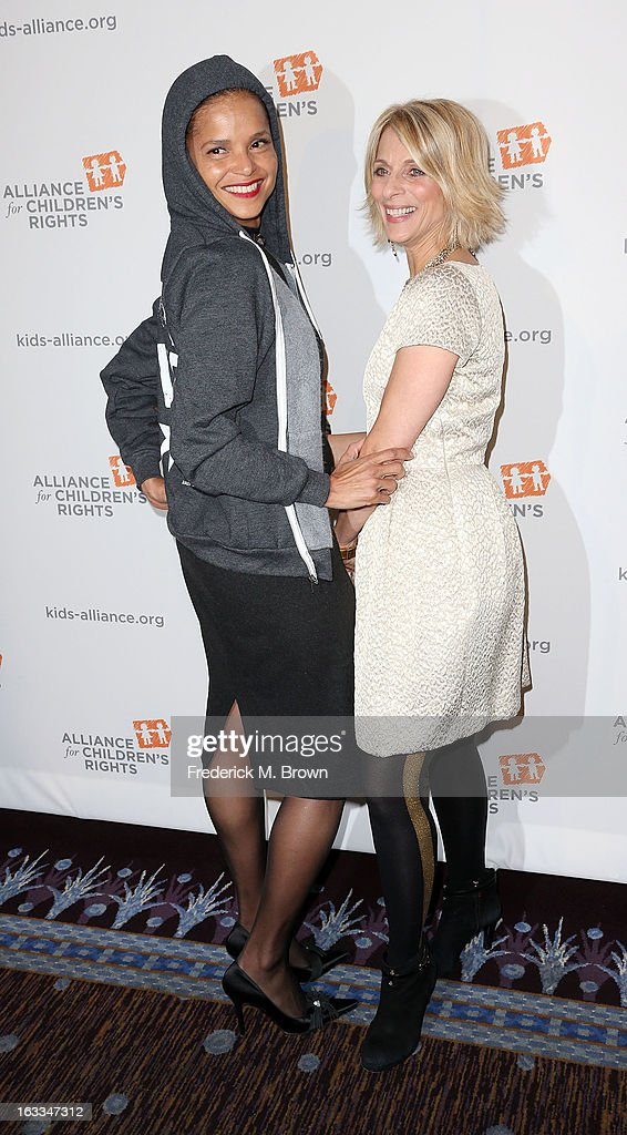 Actress <a gi-track='captionPersonalityLinkClicked' href=/galleries/search?phrase=Victoria+Rowell&family=editorial&specificpeople=202576 ng-click='$event.stopPropagation()'>Victoria Rowell</a> (L) and Janis Spire attend The Alliance For Children's Rights' 21st Annual Dinner at The Beverly Hilton Hotel on March 7, 2013 in Beverly Hills, California.