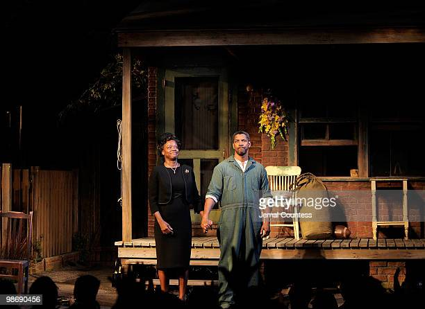 Actress Viola Davis and actor Denzel Washington take a bow during the curtain call for the Broadway Opening of 'Fences' at the Cort Theatre on April...