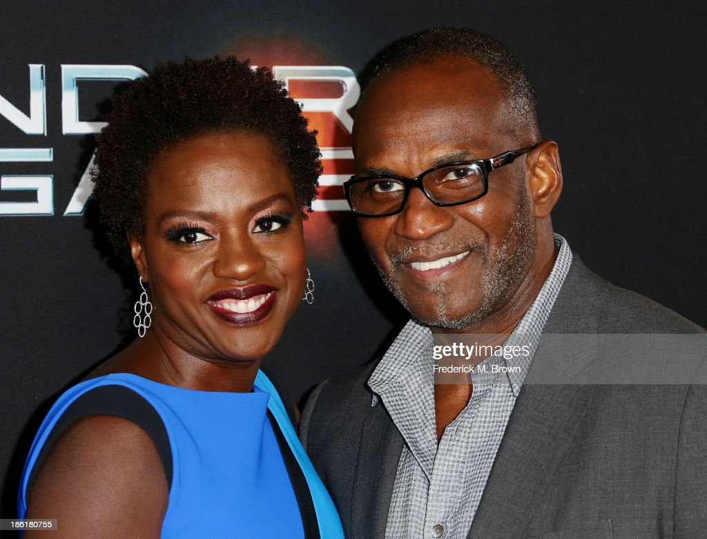 Actress Viola Davis (L) and Julius Tennon attend the Premiere of Summit Entertainment's 'Ender's Game' at the TCL Chinese Theatre on October 28, 2013 in Hollywood, California.
