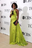 Actress Viola Davis poses with her award for Best Performance by a Leading Actress in a Play at the 64th Annual Tony Awards at The Sports Club/LA on...