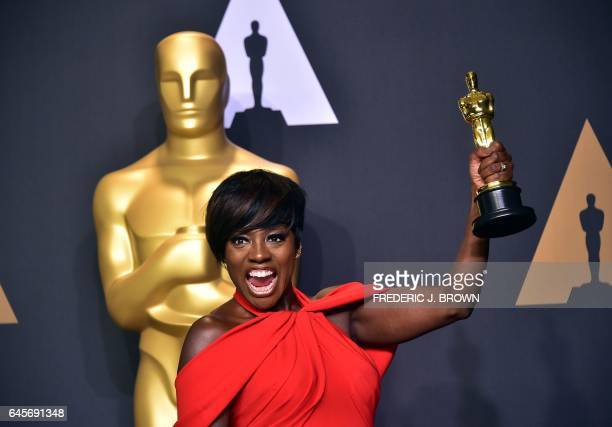 TOPSHOT Actress Viola Davis poses with the Oscar for Best Actress in a Supporting Role in the press room during the 89th Oscars on February 26 in...