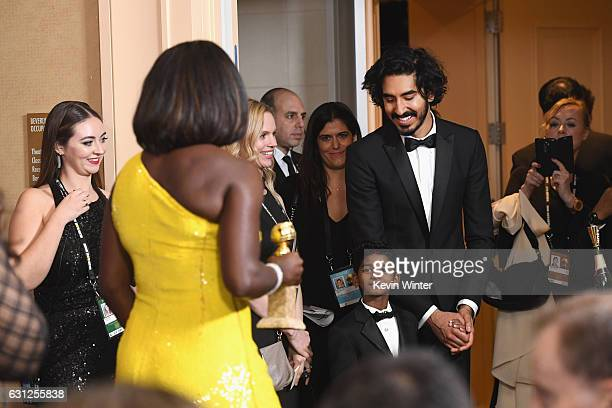 Actress Viola Davis winner of Best Supporting Actress in a Motion Picture for 'Fences' poses in the press room while actors Sunny Pawar and Dev Patel...