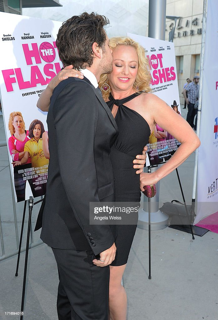 Actress Virginia Madsen (R) and Nick Holmes arrive at the premiere of 'The Hot Flashes' at ArcLight Cinemas on June 27, 2013 in Hollywood, California.