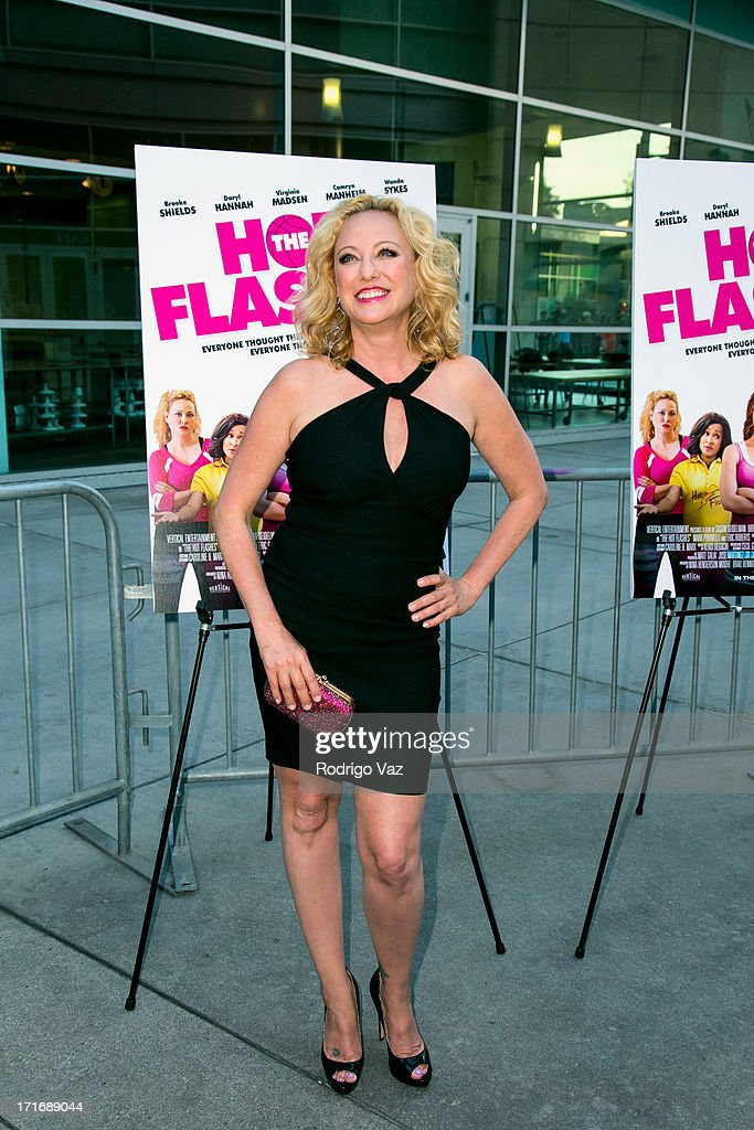 Actress <a gi-track='captionPersonalityLinkClicked' href=/galleries/search?phrase=Virginia+Madsen&family=editorial&specificpeople=202232 ng-click='$event.stopPropagation()'>Virginia Madsen</a> arrives at 'The Hot Flashes' Los Angeles premiere at ArcLight Cinemas on June 27, 2013 in Hollywood, California.