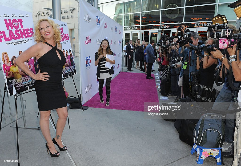 Actress Virginia Madsen arrives at the premiere of 'The Hot Flashes' at ArcLight Cinemas on June 27, 2013 in Hollywood, California.