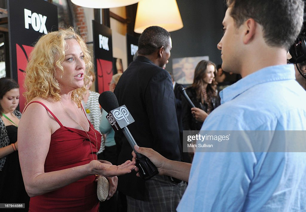 Actress <a gi-track='captionPersonalityLinkClicked' href=/galleries/search?phrase=Virginia+Madsen&family=editorial&specificpeople=202232 ng-click='$event.stopPropagation()'>Virginia Madsen</a> (L) arrives for the party to celebrate the one year anniversary of The WIGS Digital Channel at Akasha on May 2, 2013 in Culver City, California.