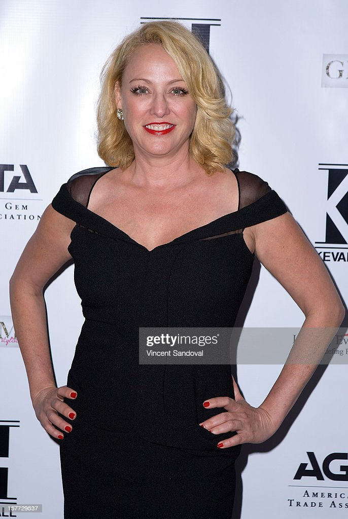Actress Virginia Madsen attends fashion designer Kevan Hall's Spring 2013 Collection on December 5, 2012 in Los Angeles, California.