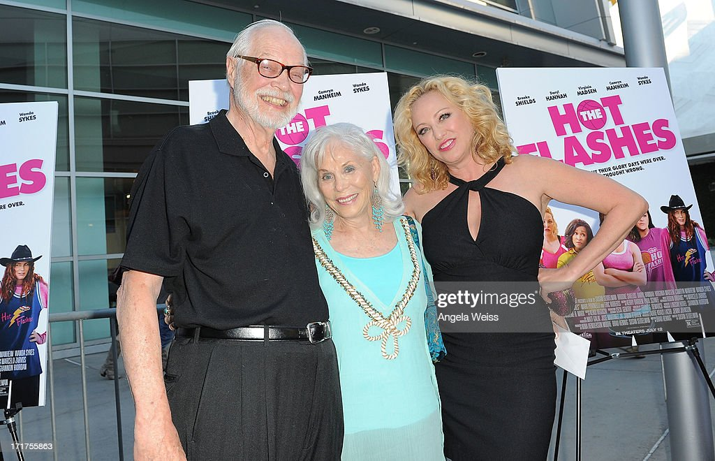 Actress Virginia Madsen (R), mom Elaine Madsen and Edward Carstens arrive at the premiere of 'The Hot Flashes' at ArcLight Cinemas on June 27, 2013 in Hollywood, California.