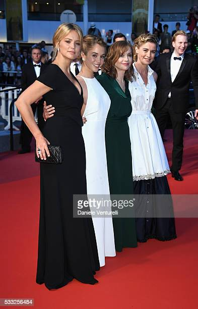 Actress Virginie Efira actress Alice Isaaz actress Isabelle Huppert and actress Anne Consigny leave the 'Elle' Premiere during the 69th annual Cannes...