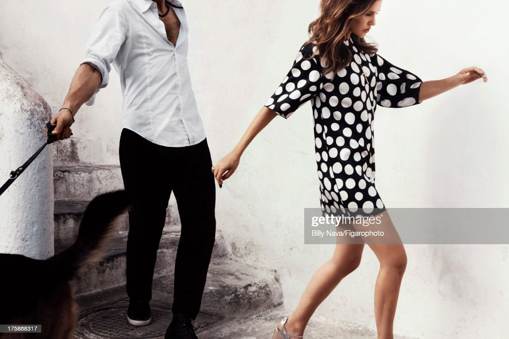 106843-003. Actress Virginie Ledoyen is photographed for Madame Figaro on July 12, 2013 in San Valentino Torio, Italy. Dress (Celine), necklace (Stone), ring (Aurelie Bidermann), shoes (Chloe). Make-up by Sisley. PUBLISHED IMAGE.