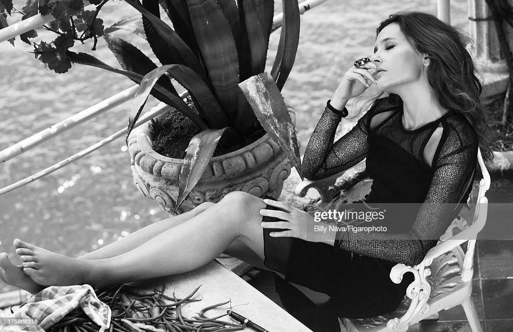 106843-004. Actress Virginie Ledoyen is photographed for Madame Figaro on July 12, 2013 in San Valentino Torio, Italy. Dress (Emilio Pucci), ring (Philippe Ferrandis). Make-up by Sisley. On the table: pen (Montblanc). PUBLISHED IMAGE.